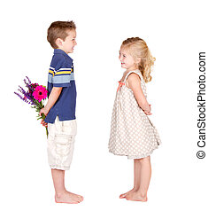 A boy and a girl with flowers - A girl looking at a boy with...