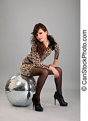 Party dancer on high heels with disco ball isolated on white...