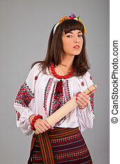 Attractive woman wears Ukrainian national dress isolated on...