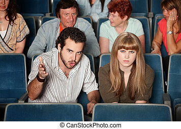 Serious Moviegoers - Serious movie fans angry in a theater