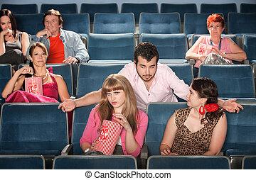 Rude Man Flirts in Theater