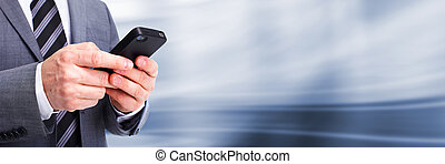 Businessman calling by phone. Technology background.