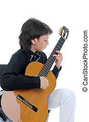 Little boy musician playing guitar - Little boy musician...