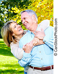 Happy senior couple - Happy senior couple in love Park...