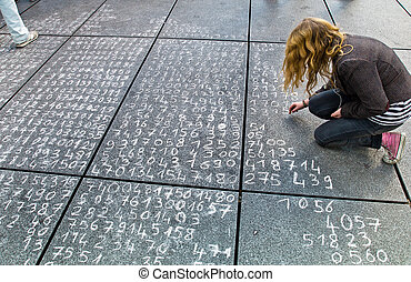 math problem on a pavement - one student wrote a math...