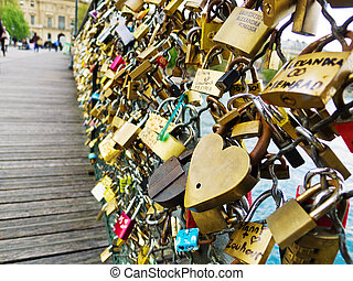 paris, france symbols of love - on a bridge over the seine...