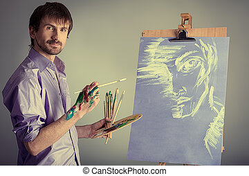 painting on easel - Portrait of an artist painting on easel....