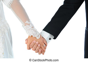 Closeup Wedding Couple Holding Hands - Closeup of a bride...