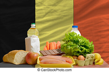basic food groceries in front of belgium national flag