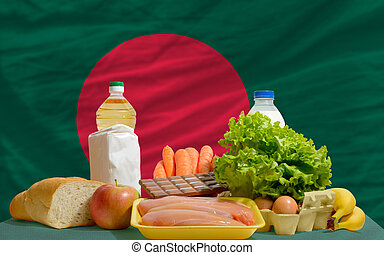 basic food groceries in front of bangladesh national flag