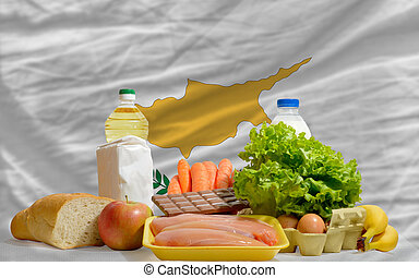 basic food groceries in front of cyprus national flag
