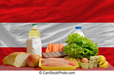 basic food groceries in front of austria national flag