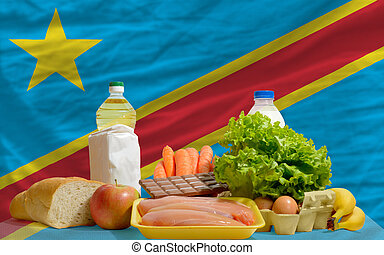 basic food groceries in front of congo national flag