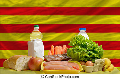 basic food groceries in front of catalonia national flag