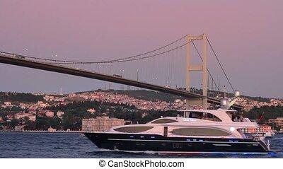 Bosporus, Istanbul - Luxury yacht sails under Bosporus...
