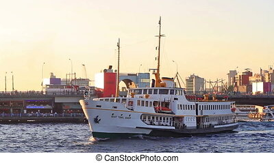 City ferryboat in front of Galata Bridge in Istanbul