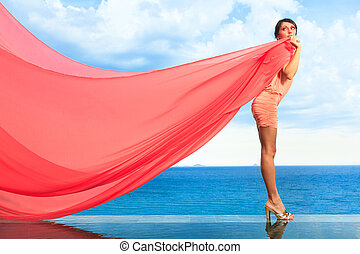 Woman with red scarf on water
