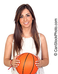 Atractive girl with a basketball ball isolated on white...