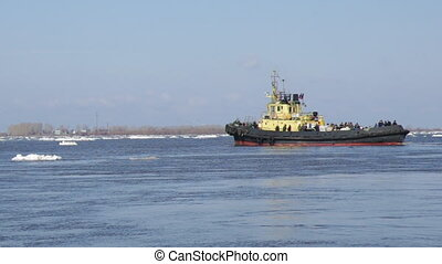 tug boat pushing through ice - tug boat pushing through ice...
