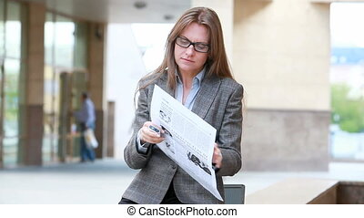 Business news outdoor - Woman in the foreground looking...