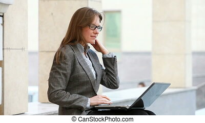 Modern business - Smiling woman looking for business options...