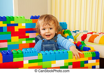 Constructing with toy blocks is fun - kid playing with toy...