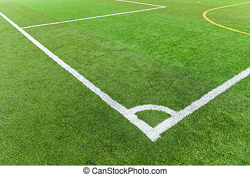 Artificial turf football field with white line corner
