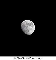Half moon - bright half moon over black sky background