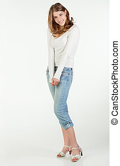 Smiling teenager girl - Full height portrait of a shy...