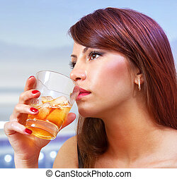 woman with glass of whisky