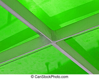 abstract metal construction covered with green material,...