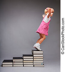 Opportunities after education - girl jumping from steps that...