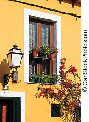 Facade of a mediterranean house with flowers