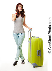 Young woman with luggage - Young woman standing with luggage...