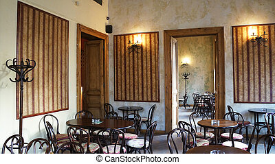Interiors of a vintage pub with wooden tables and chairs
