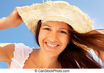 Summer smile - Close-up portrait of a smiling girl with wind...