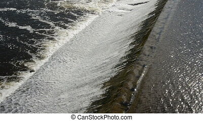 weir on the river abstract water background