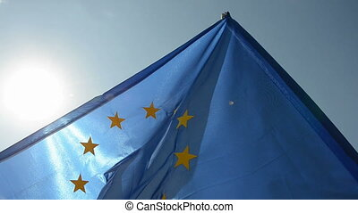 European union flag in wind and sunlight