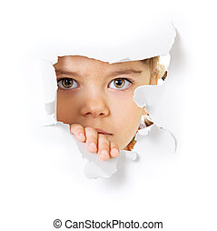 Child's face looking through a hole in paper - Face of the...