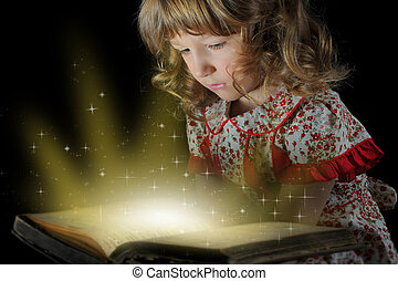 Teen girl reading the Book - Teen girl reading the book on a...