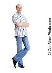 Full length portrait of a stylish young man standing...
