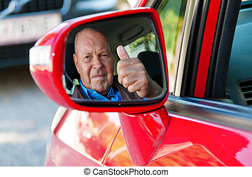 as senior drivers in the car - elderly woman in a seat belt...