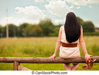 Dreaming - photo of young woman looking at the clouds while...