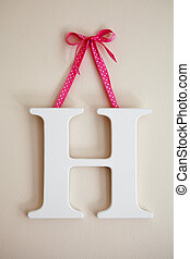 Letter H - Alphabet letter H hanging on the wall