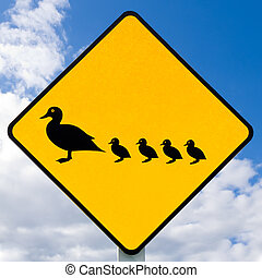 Roadsign warning, ducks with ducklings crossing - Road sign...