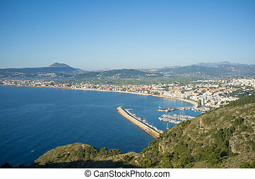 Javea bay and harbor - Javea and its fishing harbor on a...