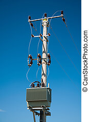 electric pylon with isolators on blue sky background