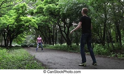 Boy and girl playing in badminton