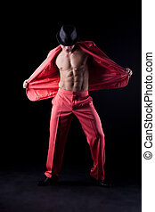 Sexy man in red suit Stripper on black background