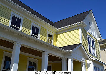 Detail of a Newly Built House - Close up detail of a yellow...
